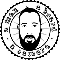 A Man A Beard A Camera