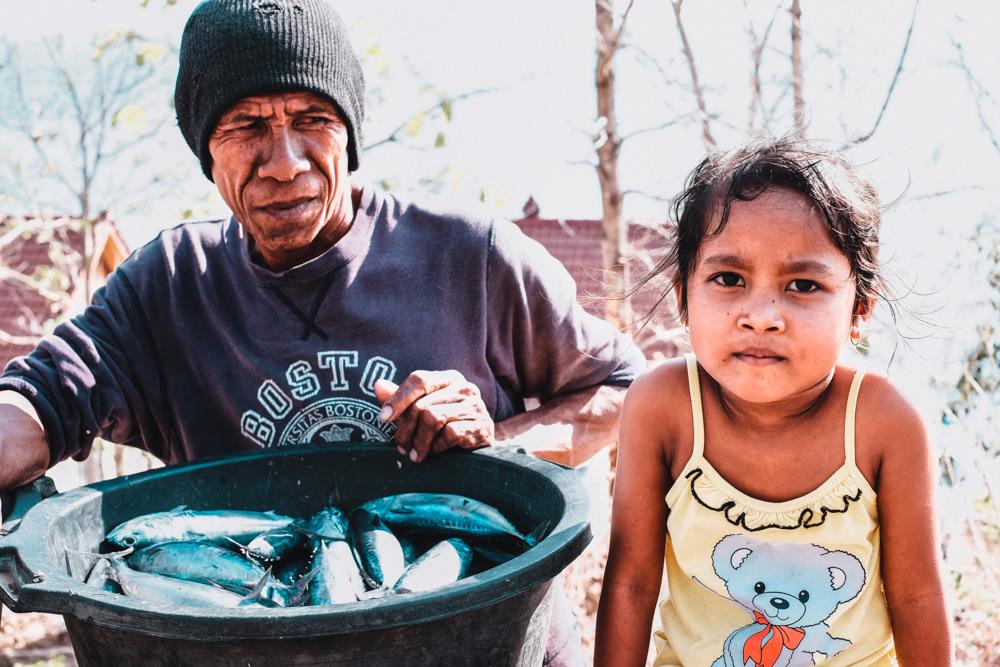 Bali, Indonesia, fisherman, daughter, fish in a bucket,