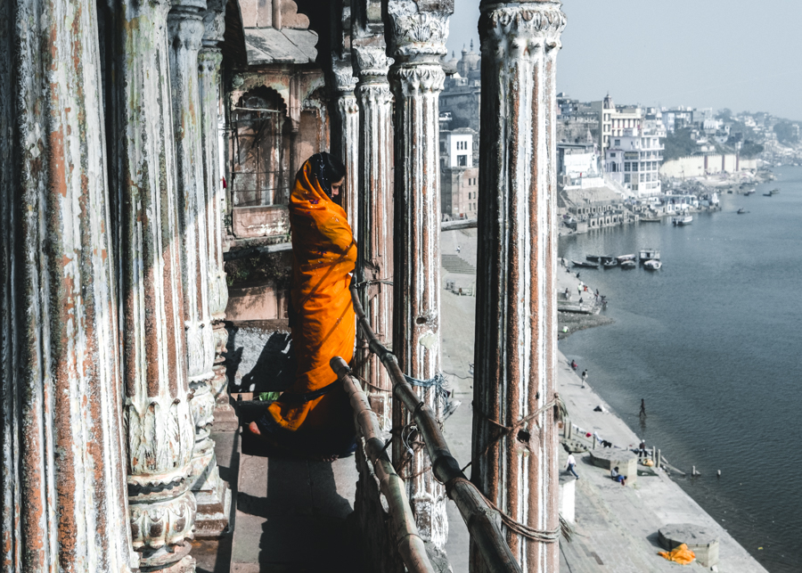 Girl-orange-robe-river-ganges-varanasi-India